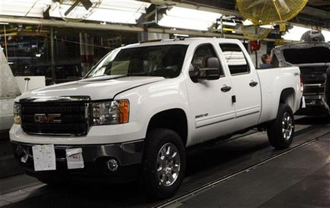 A 2011 GMC Sierra pickup truck moves down the final production line at the Flint Assembly in Flint, Michigan January 24, 2011. REUTERS/Rebec