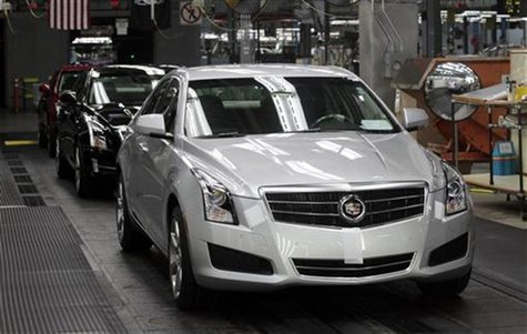 A 2013 ATS Cadillac luxury vehicle waits to roll of the final line at the Lansing Grand River Assembly Plant in Lansing, Michigan July 26, 2