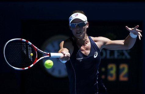 Samantha Stosur of Australia hits a return to Chang Kai-Chen of Taiwan during their women's singles match at the Australian Open tennis tour