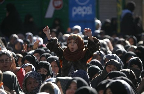 A girl from the Shi'ite Hazara community gestures as she attends a funeral ceremony of the victims who were killed three days ago by a bomb