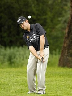 Louis Oosthuizen of South Africa plays a shot on the 7th hole during the final of the 2012 Nedbank Golf Challenge in Sun City, December 2, 2