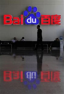 A security guard walks past the company logo of Baidu at its headquarters in Beijing, July 26, 2011. REUTERS/Soo Hoo Zheyang