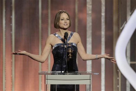 Actress Jodie Foster (L) accepts the Cecil B. Demille Award, on stage on at the Golden Globe Awards in Beverly Hills, California January 13,