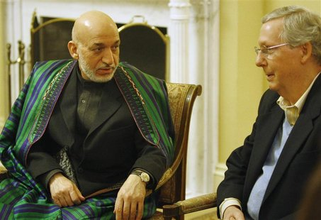 Afghan President Hamid Karzai (L) meets with Senate Minority Leader Mitch McConnell (R-KY) (R) at the U.S. Capitol in Washington January 9,