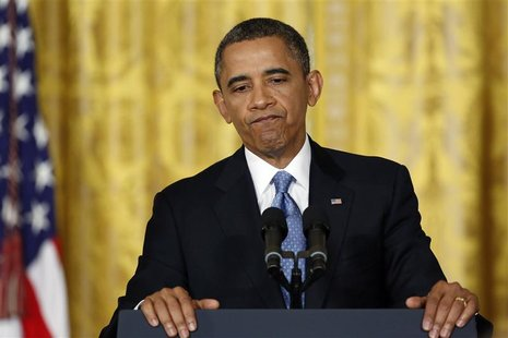 U.S. President Barack Obama pauses during remarks at a news conference at the White House in Washington, January 14, 2013. REUTERS/Jonathan