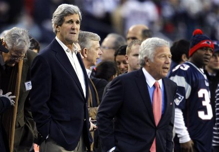 U.S Senator and Nominee for U.S. Secretary of State John Kerry (L) (D-Massachusetts) stands on the sidelines with New England Patriots owner