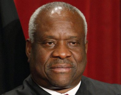 U.S. Supreme Court Justice Clarence Thomas poses for an official photograph with the other Justices at the Supreme Court in Washington, in t