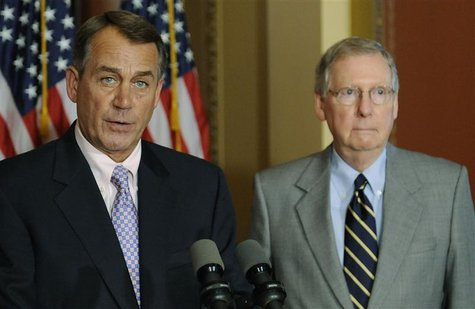 U.S. House Speaker John Boehner (R-OH) (L) and Senate Minority Leader Mitch McConnell (R-KY) (R) hold a news conference about the U.S. debt