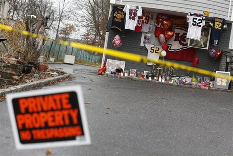 A makeshift memorial for Kansas City Chiefs football player Jovan Belcher is seen outside his mother's home in West Babylon, New York Decemb