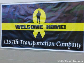 A sign welcoming home the soldiers of the 1157th Transportation Co. is seen, Jan. 14, 2013. (courtesy of FOX 11).