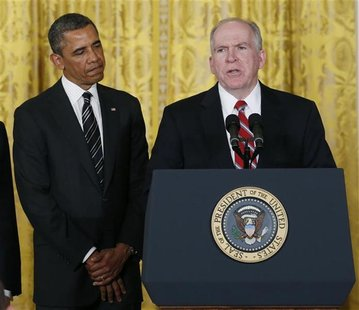 U.S. President Barack Obama (L) stands next to John Brennan, (R), during the announcement for his nominations for a new secretary of defense