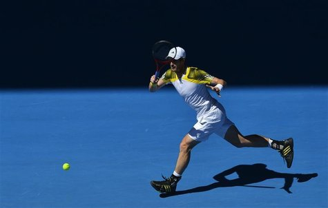 Andy Murray of Britain hits a return to Robin Haase of Netherlands during their men's singles match at the Australian Open tennis tournament
