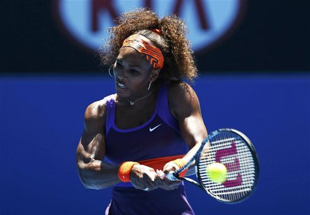 Serena Williams of the U.S. hits a return to Edina Gallovits-Hall of Romania during their women's singles match at the Australian Open tenni