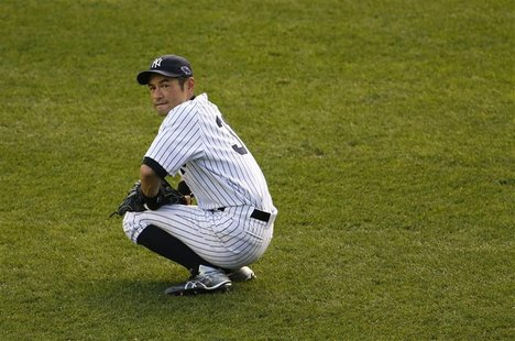 New York Yankees left fielder Ichiro Suzuki pauses during a break in play against the Detroit Tigers in the seventh inning of Game 2 of thei