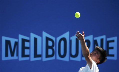 Wu Di of China serves to Ivan Dodig of Croatia during their men's singles match at the Australian Open tennis tournament in Melbourne Januar
