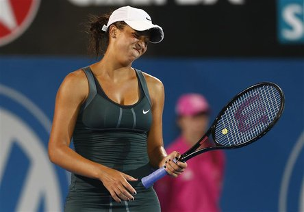Madison Keys of the U.S. reacts after missing a point against Li Na of China during their women's singles match at the Sydney International