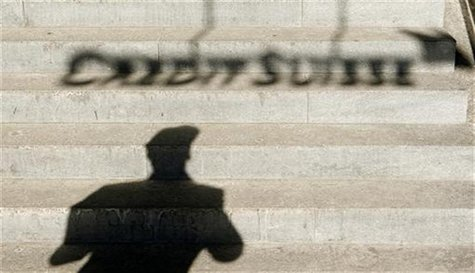 A the shadow of a man and of the logo of Swiss bank Credit Suisse are thrown on stairs in Zurich February 6, 2012. J REUTERS/Arnd Wiegmann