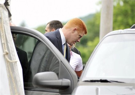 Mike McQueary, Penn State University assistant football coach on leave, exits the Courthouse after testifying in the Jerry Sandusky child se