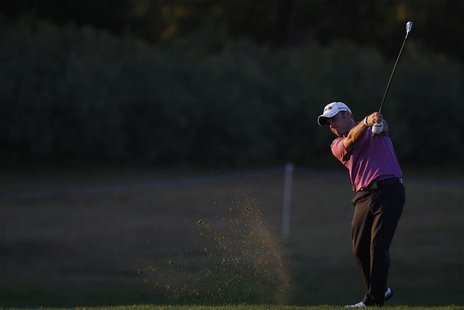 Paul McGinley of Ireland hits a shot on the 18th hole during the first round of the Portugal Masters golf tournament in Vilamoura October 14