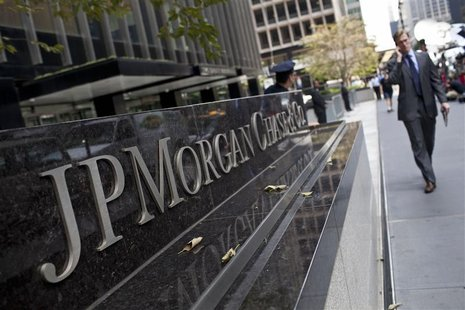 A man walks past JPMorgan Chase & Co's international headquarters on Park Avenue in New York July 13, 2012. REUTERS/Andrew Burton