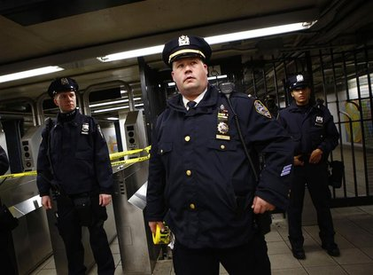 Police officers are seen at a closed subway station in New York January 15, 2013. REUTERS/Eric Thayer
