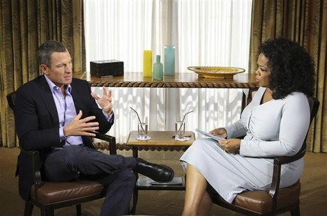 Cyclist Lance Armstrong is interviewed by Oprah Winfrey in Austin, Texas, in this January 14, 2012 handout photo courtesy of Harpo Studios.