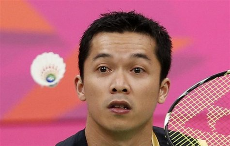 Indonesia's Taufik Hidayat plays against China's Lin Dan during their men's singles round of 16 badminton match during the London 2012 Olymp