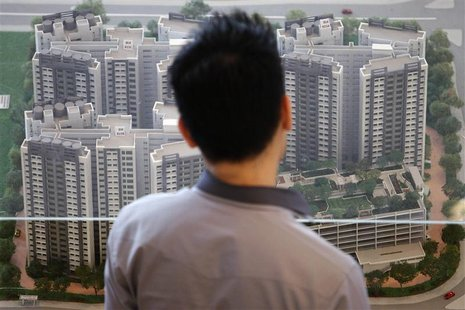 A man looks at a model of a new public housing estate to be launched at the Housing Development Board (HDB) gallery in Singapore January 15,