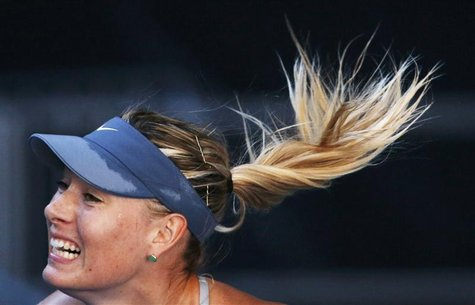 Maria Sharapova of Russia serves to Misaki Doi of Japan during their women's singles match at the Australian Open tennis tournament in Melbo