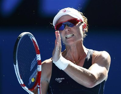 Samantha Stosur of Australia reacts during her women's singles match against Zheng Jie of China at the Australian Open tennis tournament in