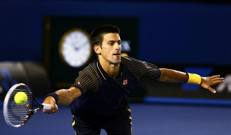 Novak Djokovic of Serbia hits a return to Ryan Harrison of the U.S. during their men's singles match at the Australian Open tennis tournamen