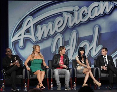"Judges Randy Jackson (L-R), Mariah Carey, Keith Urban, Nicki Minaj and host Ryan Seacrest attend a Fox panel for the television series ""Amer"