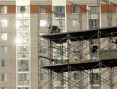 A construction worker erects scaffolding at a new apartment complex under construction in Silver Spring, Maryland January 31, 2012. REUTERS/