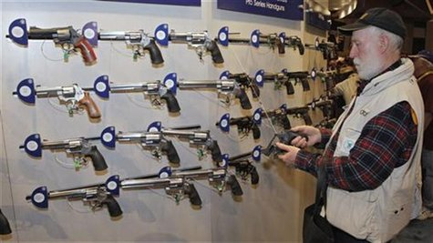 Homer Van Meter, of Rhineland, WI, inspects a revolver during the National Rifle Association's (NRA) 141st Annual Meetings & Exhibits in St.