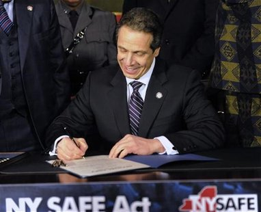 New York Governor Andrew Cuomo signs the New York Secure Ammunition and Firearms Enforcement Act at the Capitol in Albany, New York January