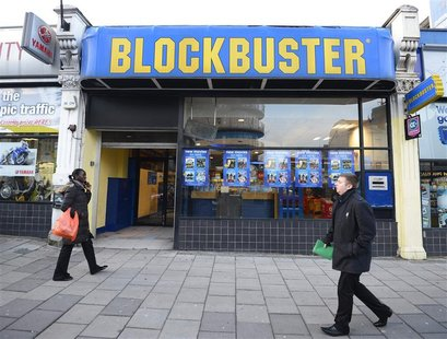 People walk past a Blockbuster shop in south London January 16, 2013. REUTERS/Paul Hackett