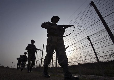 Indian Border Security Force (BSF) soldiers patrol the fenced border with Pakistan in Suchetgarh, southwest of Jammu January 16, 2013. Two P