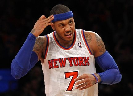 New York Knicks forward Carmelo Anthony reacts after hitting a three-point shot against the New Orleans Hornets in the second quarter of the