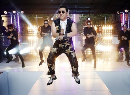 "South Korean singer Psy performs his hit ""Gangnam Style"" during a morning television appearance in central Sydney October 17, 2012. REUTERS/"