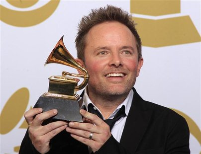 Chris Tomlin poses backstage after winning Best Contemporary Christian Music Album at the 54th annual Grammy Awards in Los Angeles, Californ