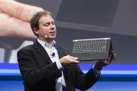 Kirk Skaugen, Intel's vice president of PC client group, converts a Lenovo Yoga Ultrabook into a tablet, at an Intel news conference during