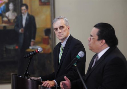 U.S. Deputy National Security Advisor Denis Mcdonough (L) listens to Honduras' Foreign Minister Arturo Corrales during a joint news conferen