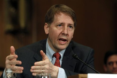 Consumer Financial Protection Bureau Director Richard Cordray testifies before a Senate Banking, Housing and Urban Affairs Committee hearing