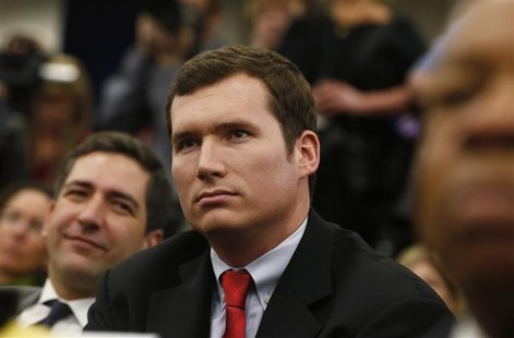 Virginia Tech shooting survivor Colin Goddard attends a White House event during which U.S. President Barack Obama unveiled a series of gun