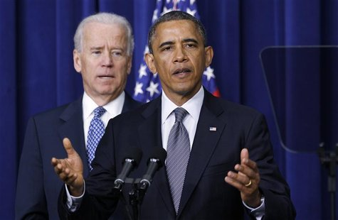U.S. President Barack Obama (R) and Vice President Joe Biden announce a series of proposals to counter gun violence during an event at the W