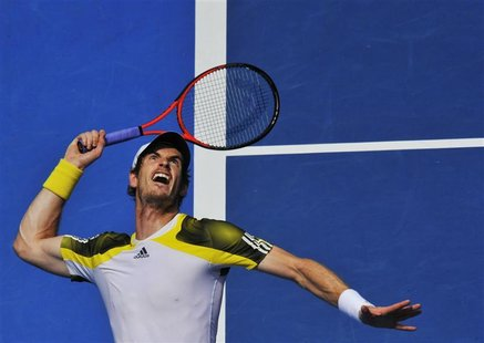 Andy Murray of Britain serves to Joao Sousa of Portugal during their men's singles match at the Australian Open tennis tournament in Melbour