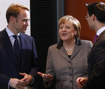 German Chancellor Angela Merkel (C) and Economy Minister Philipp Roesler (R) chat with President of German Bundesbank Jens Weidmann before t