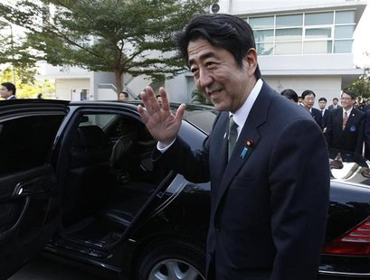 Japan's Prime Minister Shinzo Abe waves before he leaves the Thai-Nichi Institute of Technology in Bangkok January 17, 2013. Abe is on a one