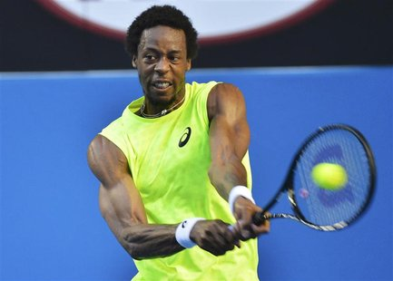 Gael Monfils of France hits a return to Lu Yen-Hsun of Taiwan during their men's singles match at the Australian Open tennis tournament in M