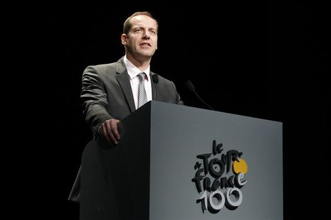 Tour de France director Christian Prudhomme presents the itinerary of the 2013 Tour de France cycling race during a news conference in Paris